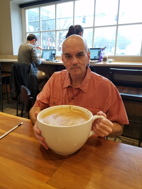 """Bill Lewis ready to sip his """"most expensive Starbucks coffee"""" ©SouthFloridaReporter.com"""