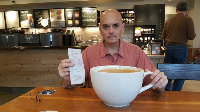 """Bill Lewis with the receipt and cup of """"most expensive Starbucks coffee"""" ©SouthFloridaReporter.com"""