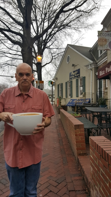 """Bill Lewis and his cup of """"most expensive Starbucks coffee"""" ©SouthFloridaReporter.com"""