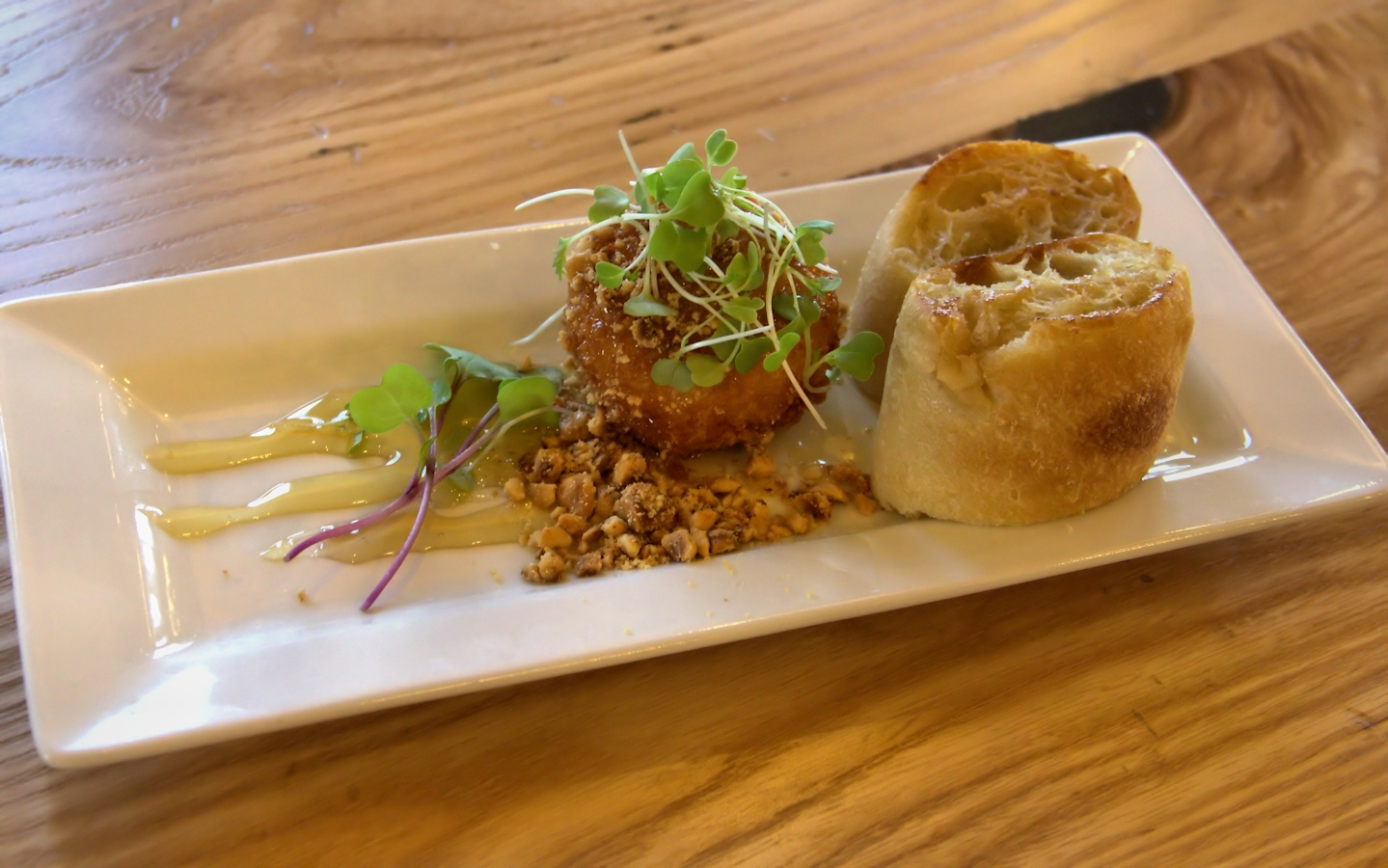 Fried goat cheese with hazelnuts and honey