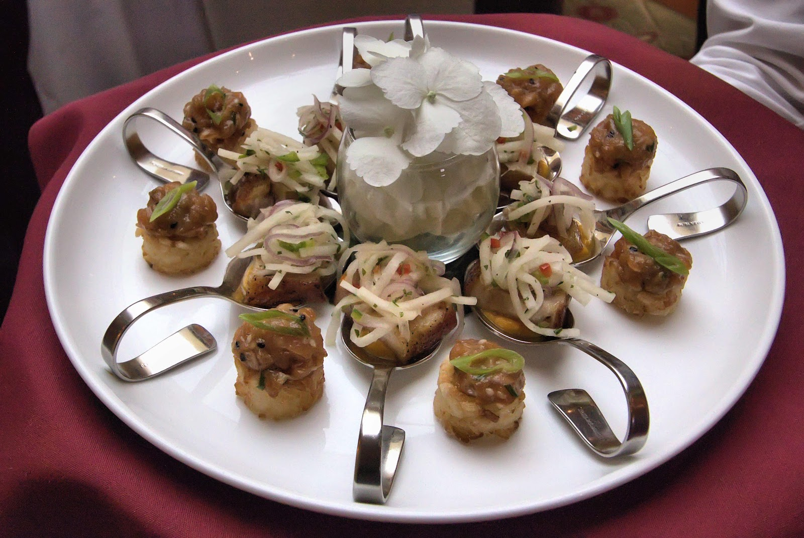 Pork belly and salmon crudo appetizer spoons