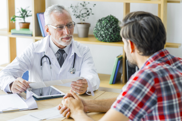 https://www.freepik.com/free-photo/elderly-doctor-listening-young-patient_3019418.htm#page=1&query=man%20talks%20doctor&position=12