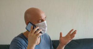 https://www.freepik.com/premium-photo/man-is-sitting-sofa-protective-mask-with-laptop-phone-remote-work-quarantine_9100712.htm#page=1&query=COVID%20BALD&position=4
