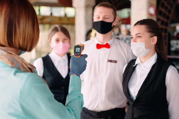 https://www.freepik.com/premium-photo/manager-restaurant-hotel-checks-body-temperature-staff-with-thermal-imaging-device_7975717.htm