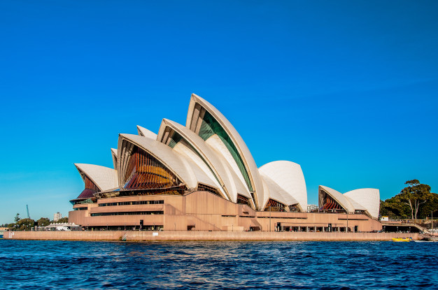 https://www.freepik.com/free-photo/sydney-opera-house-near-beautiful-sea-clear-blue-sky_9283174.htm#page=1&query=australian%20city&position=5