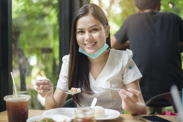 https://www.freepik.com/premium-photo/young-woman-with-face-mask-is-having-food-restaurant-new-normal-concept_9102365.htm#page=3&query=mask+restaurant&position=22