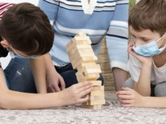 https://www.freepik.com/free-photo/kids-with-medical-masks-playing-jenga-with-mother_7747088.htm