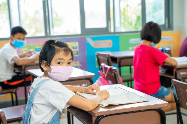 https://www.freepik.com/premium-photo/group-asian-children-wearing-protective-mask-protect-against-covid-19-sitting-desk-classroom-elementary-school-social-distancing-coronavirus-has-turned-into-global-emergency_9384090.htm#page=2&query=covid+classroom&position=4