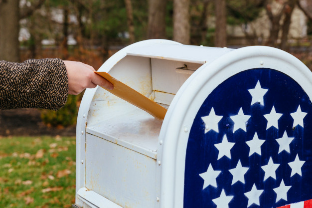 https://www.freepik.com/premium-photo/close-up-postman-putting-letters-mailbox-american-flag_5330270.htm#page=1&query=US%20Post%20Office&position=2