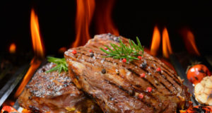 https://www.freepik.com/premium-photo/grilled-beef-steak-with-vegetable-flaming-grill_5383402.htm