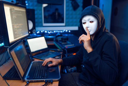 https://www.freepik.com/premium-photo/hacker-mask-hood-sitting-his-workplace-with-laptop-pc-network-account-hacking_9682768.htm