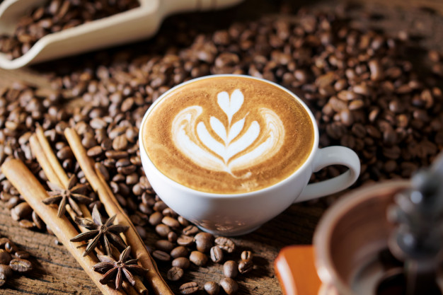 https://www.freepik.com/premium-photo/white-coffee-cup-roasted-coffee-beans-around_5064520.htm#page=1&query=coffee&position=7