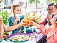 https://www.freepik.com/premium-photo/friends-drinking-spritz-cocktail-bar-with-face-masks_8831209.htm#page=1&query=covid%20bar&position=34