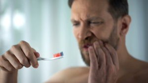 https://www.istockphoto.com/photo/male-in-bathroom-looking-at-blood-toothbrush-oral-hygiene-parodontosis-illness-gm1076954194-288448279