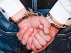 https://www.freepik.com/premium-photo/young-businessman-handcuffs-stands-with-his-back_8900076.htm