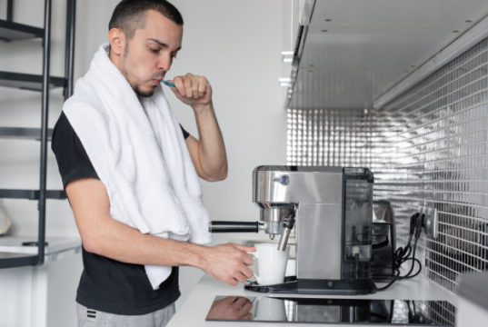 https://www.freepik.com/premium-photo/young-guy-is-going-work-morning-brushes-teeth-near-coffee-machine-while-waiting-cup-coffee_7254208.htm#page=6&query=home+coffee+maker&position=14