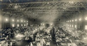 https://en.wikipedia.org/wiki/Spanish_flu#/media/File:Emergency_hospital_during_Influenza_epidemic,_Camp_Funston,_Kansas_-_NCP_1603.jpg