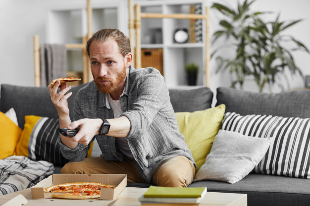 https://www.freepik.com/premium-photo/single-man-eating-pizza-while-watching-tv_8790699.htm#page=1&query=couch%20potato&position=39