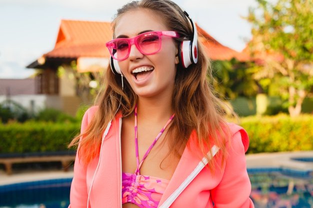 https://www.freepik.com/free-photo/attractive-woman-doing-sports-pool-colorful-pink-hoodie-wearing-sunglasses-listening-music-headphones-summer-vacation-play-tennis-sport-style_10523285.htm#page=4&query=headphones&position=20