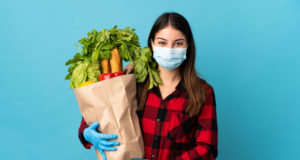 https://www.freepik.com/premium-photo/young-caucasian-with-vegetables-mask-isolated-blue-smiling-lot_9463823.htm#page=1&query=covid%20diet&position=16