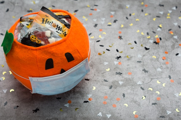 https://www.freepik.com/premium-photo/halloween-pumpkin-made-fabric-with-mask-filled-with-jelly-beans-decorated-with-halloween-motifs_10221951.htm#page=2&query=covid+halloween&position=11
