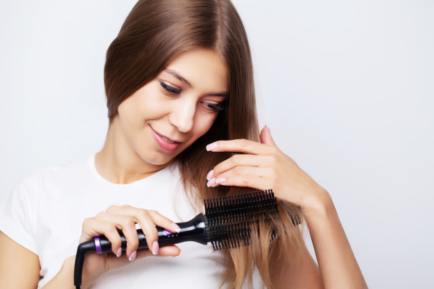 https://www.freepik.com/premium-photo/young-woman-with-luxurious-hair-straightens-it-with-curling-iron_9066326.htm#page=1&query=hair%20straightening%20brush&position=23