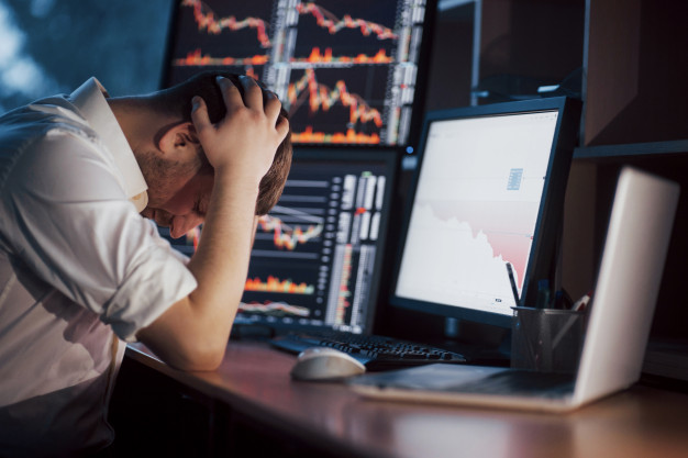 https://www.freepik.com/premium-photo/stressful-day-office-young-businessman-holding-hands-his-face-while-sitting-desk-creative-office-stock-exchange-trading-forex-finance-graphic_6180185.htm