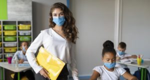 https://www.freepik.com/free-photo/kids-teacher-protecting-themselves-with-medical-masks_10143850.htm#page=1&query=covid%20school&position=44