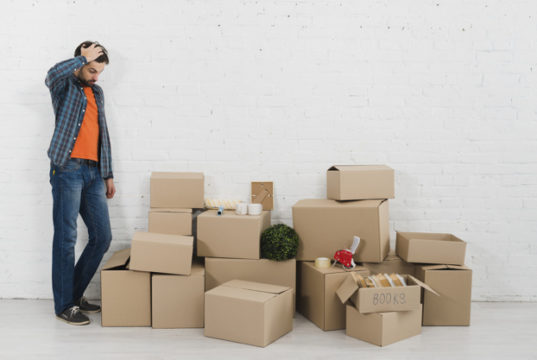https://www.freepik.com/premium-photo/confused-young-man-looking-piles-cardboard-boxes-against-white-brick-wall_4273526.htm#page=4&query=moving&position=2