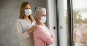 https://www.freepik.com/premium-photo/senior-woman-with-caring-daughter-home-wearing-medical-masks-as-protection-from-coronavirus_10956498.htm#page=3&query=senior+covid&position=45