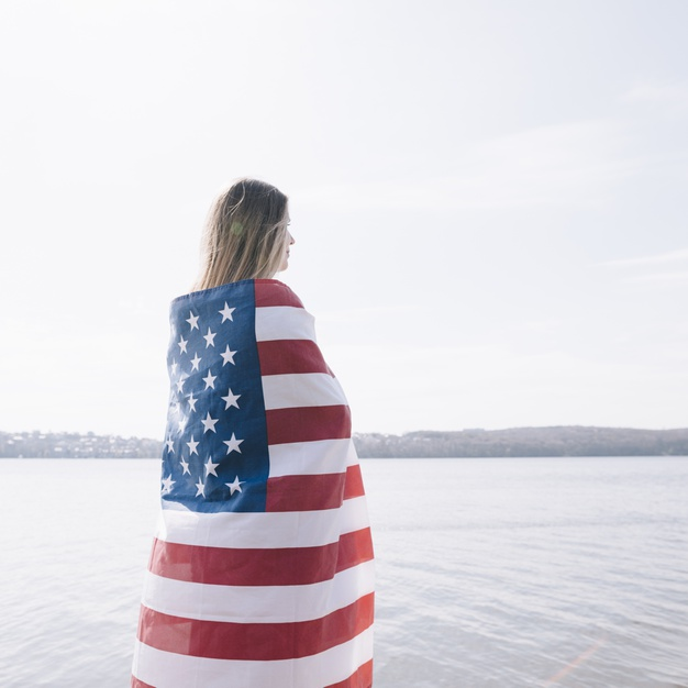 https://www.freepik.com/free-photo/woman-standing-completely-wrapped-american-flag-looking-sea_4577693.htm#page=2&query=wrapped+american+flag&position=18