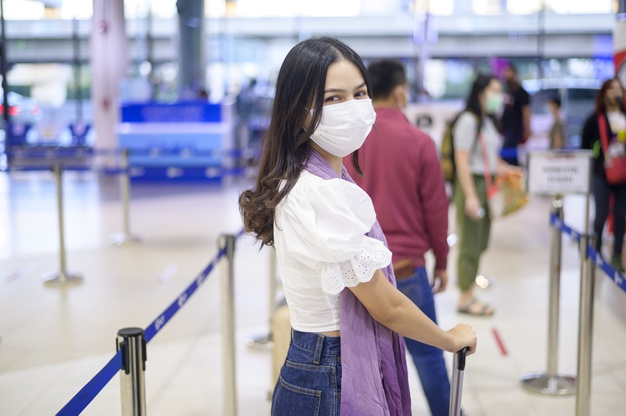 https://www.freepik.com/premium-photo/traveller-woman-is-wearing-protective-mask-international-airport-travel-covid-19-pandemic-safety-travels-social-distancing-protocol_10099047.htm