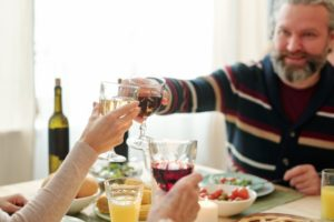 https://www.freepik.com/premium-photo/mature-man-his-daughter-clinking-with-glasses-wine-snacks-served-table-family-dinner-thanksgiving-day_10488430.htm