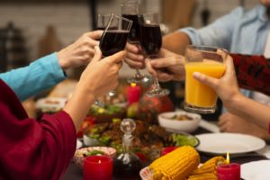 https://www.freepik.com/free-photo/family-toasting-glasses-thanksgiving-event_5682430.htm#page=1&query=thanksgiving%20wine&position=30