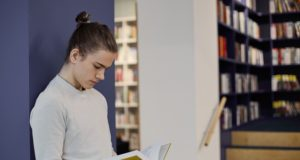 https://www.freepik.com/free-photo/student-with-hair-knot-standing-library-isolated-reading-information-open-textbook-his-hands-while-making-research_10897443.htm