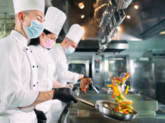 https://www.freepik.com/premium-photo/chefs-protective-masks-gloves-prepare-food-kitchen-restaurant-hotel_8372130.htm