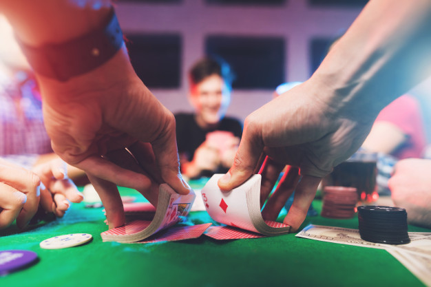 https://www.freepik.com/premium-photo/young-people-play-poker-with-alcohol_5026685.htm#page=2&query=gambling&position=7