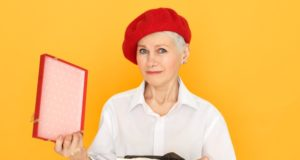 https://www.freepik.com/free-photo/portrait-sad-frustrated-mature-retired-female-red-beret-holding-box-unpacking-present-valentine-s-day_11555963.htm#page=2&query=gift+giving&position=9