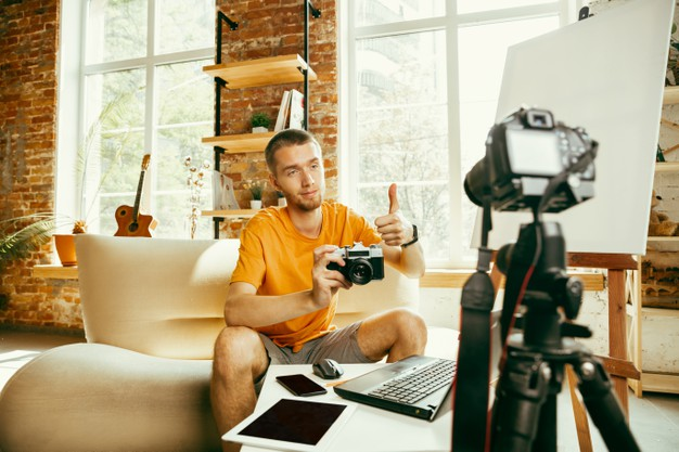 https://www.freepik.com/free-photo/young-caucasian-male-blogger-with-professional-equipment-recording-video-review-camera-home-blogging-videoblog-vlogging-man-making-vlog-live-stream-about-photo-technical-novelty_11529839.htm