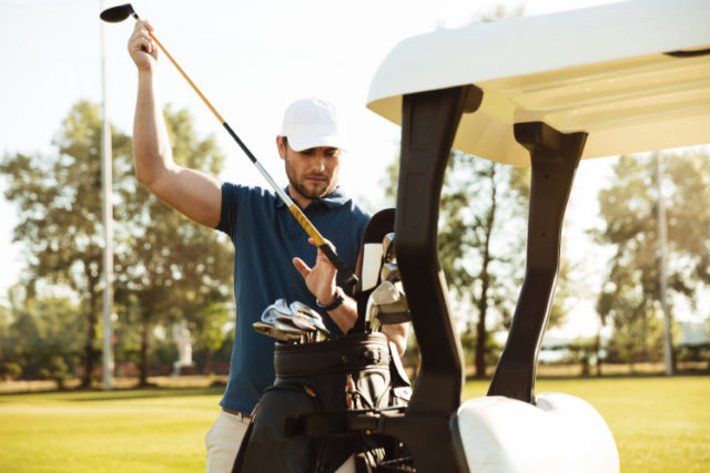 https://www.storyblocks.com/images/stock/handsome-male-golfer-taking-clubs-from-a-bag-in-a-golf-cart-at-the-green-course-rrxauntcbj7qoduh2