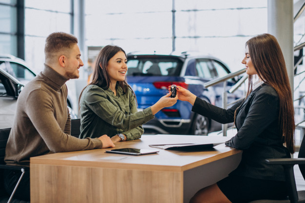 https://www.freepik.com/free-photo/young-couple-talking-sales-person-car-showroom_7200775.htm