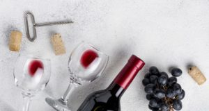 https://www.freepik.com/free-photo/flat-lay-red-wine-bottle-table_6595516.htm