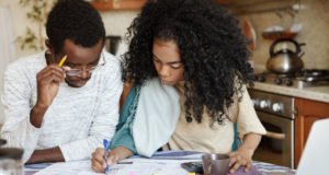 https://www.freepik.com/free-photo/young-confident-african-housewife-with-afro-hairstyle-helping-her-husband-manage-domestic-finances-calculating-making-notes-with-pen-both-sitting-kitchen-table-with-laptop-papers_9535267.htm#page=1&query=bankrupt%20couple&position=21