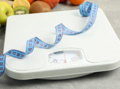 https://www.freepik.com/premium-photo/scales-measuring-tape-vegetarian-food-gray-floor_8996311.htm