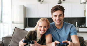 https://www.freepik.com/free-photo/happy-lovers-looking-camera-while-playing-video-games-home_6812721.htm