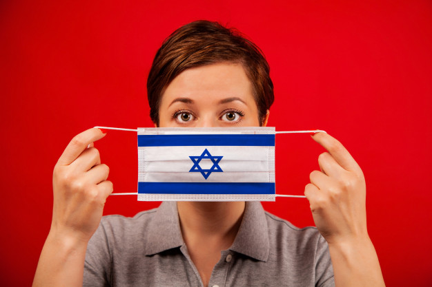 https://www.freepik.com/premium-photo/coronavirus-covid-19-israel-woman-medical-protective-mask-with-image-flag-israel_7367472.htm#page=1&query=israel%20covid%20vaccine&position=21