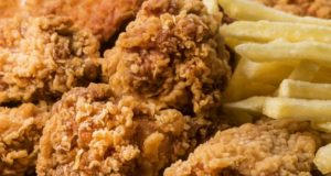 https://www.freepik.com/free-photo/close-up-fried-chicken-wings-with-fries_10417322.htm