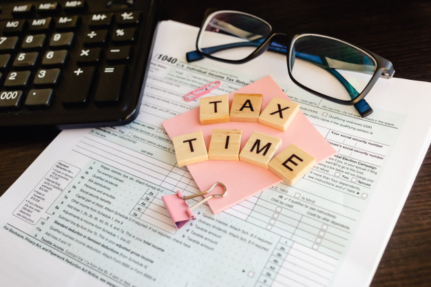 https://www.freepik.com/premium-photo/tax-time-wooden-letters-tax-form-with-sticker-glasses-calculator_9727994.htm