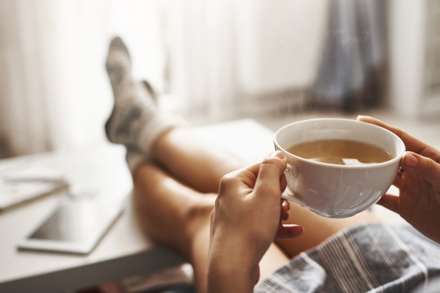 https://www.freepik.com/free-photo/cup-tea-chill-woman-lying-couch-holding-legs-coffee-table-drinking-hot-coffee-enjoying-morning-being-dreamy-relaxed-mood-girl-oversized-shirt-takes-break-home_8757184.htm#page=1&query=cozy&position=5