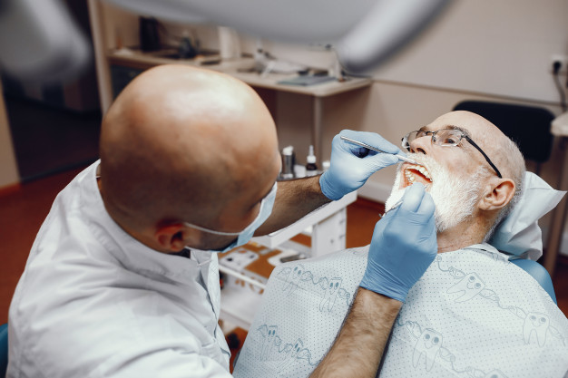 https://www.freepik.com/free-photo/old-man-sitting-dentist-s-office_4063974.htm#page=1&query=dental%20implants&position=34